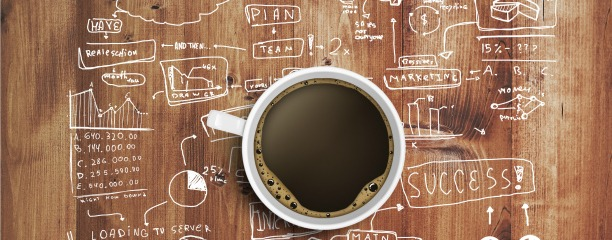 Coffee Cup And Business Strategy On Wooden Table