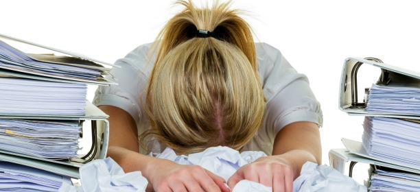 Young Woman In The Office Is Overwhelmed With Work. Burnout In Work Or Study.